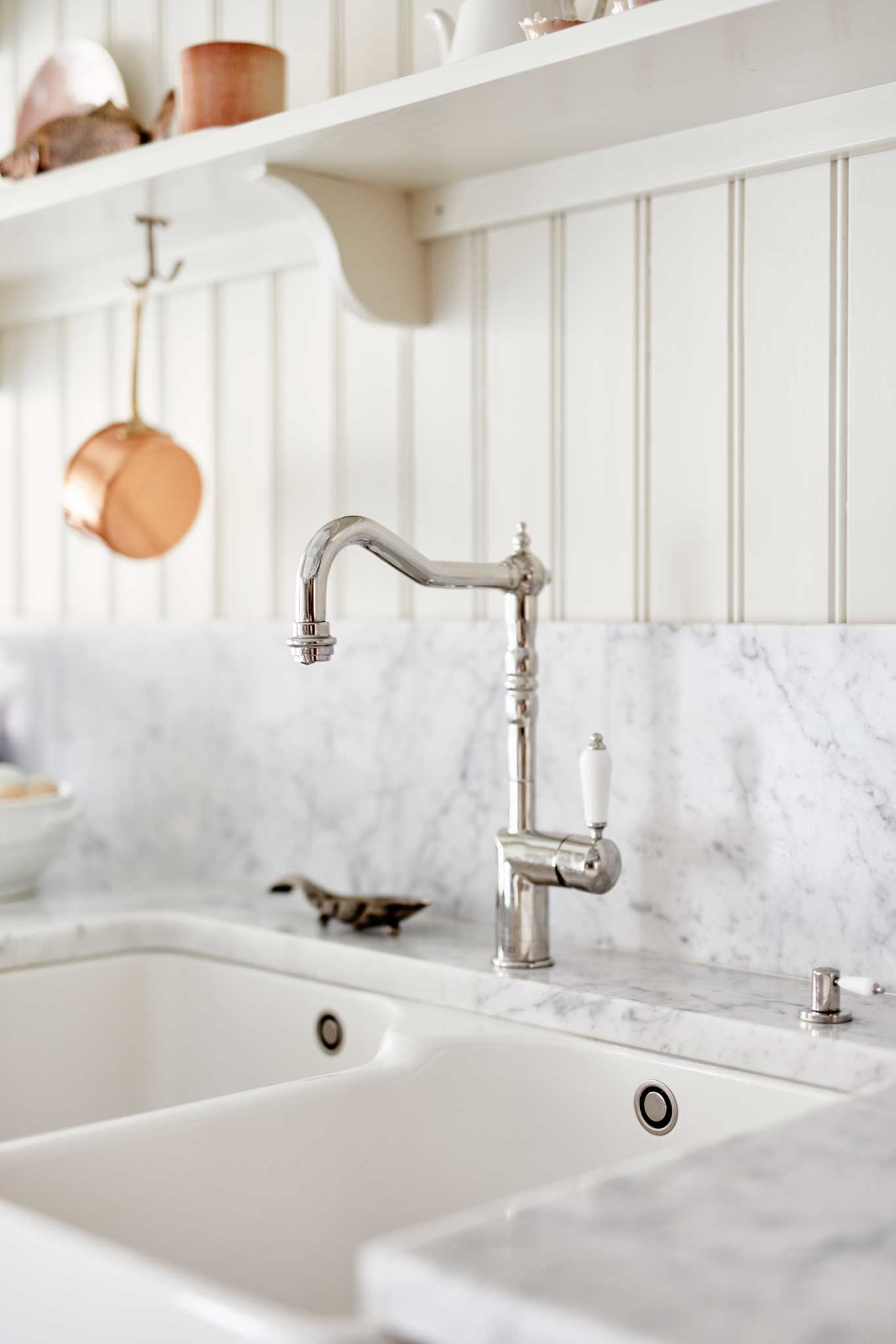 Cream colored Scandinavian Shaker Kitchen old-fashioned tap